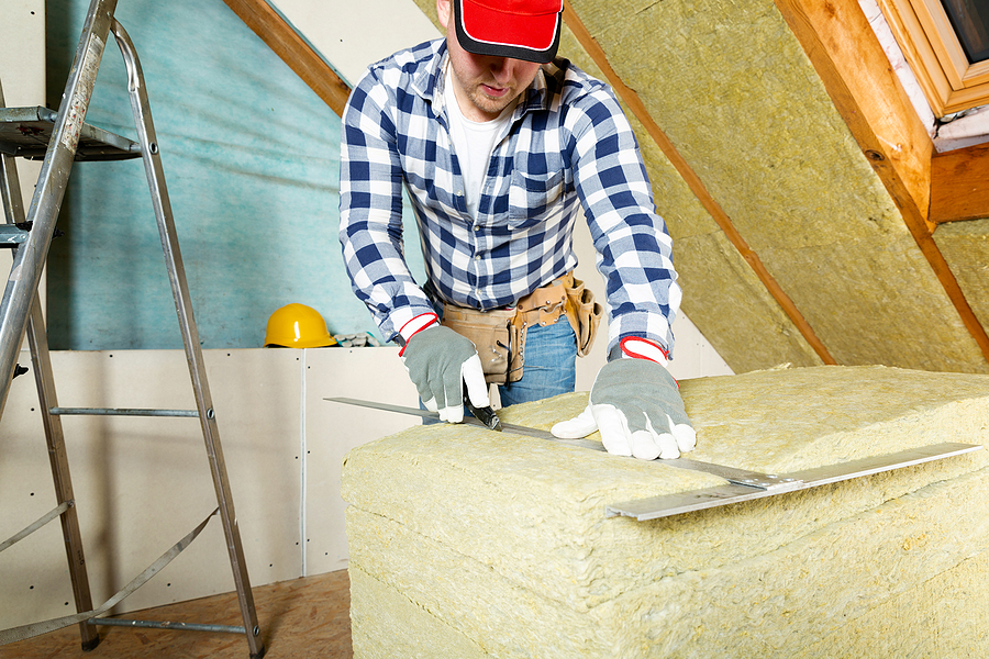contractor measuring the insulation